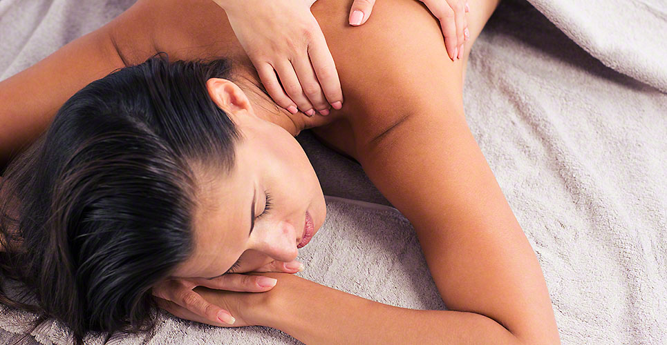 Masseur doing massage on woman