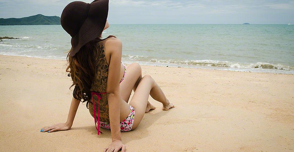 beautiful lady wear bikini laying on the beach