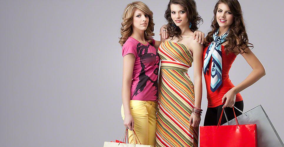 studio image three beautiful young women holding shopping bags s