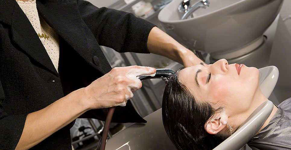 Shampoo Time Stylist Uses Wand to Rinse Clients Hair