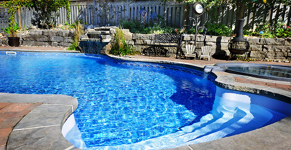 Swimming pool accented with a waterfall