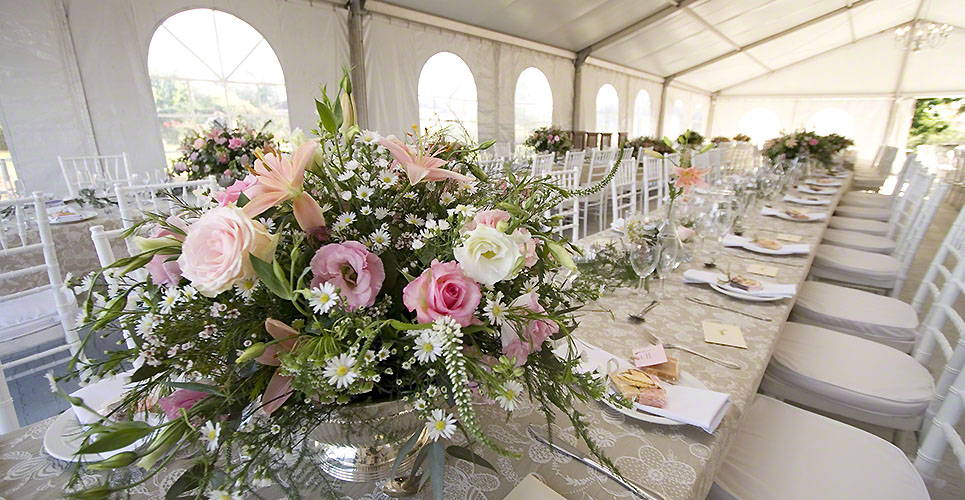 Wedding flowers on a long table