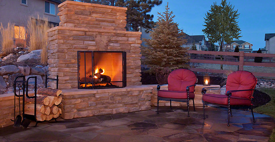 Outdoor flagstone platform with fireplace, chairs
