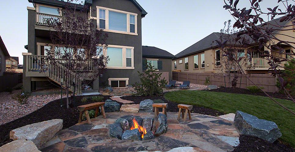 Landscaped backyard with beautiful Fire pit