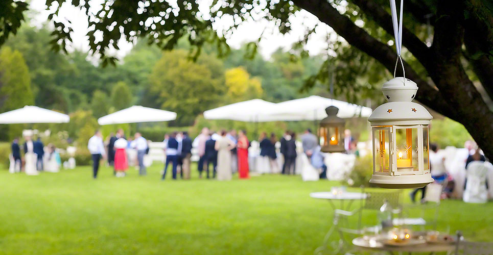 Outdoor wedding reception with green scenery