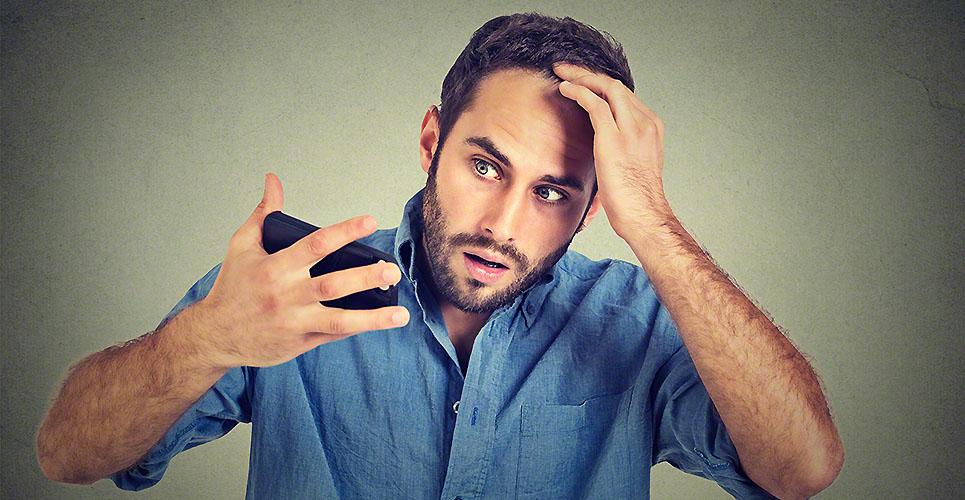 shocked man feeling head, surprised losing hair, receding hairline