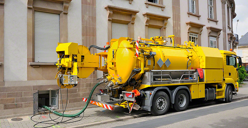 Sewage truck working in urban city environment