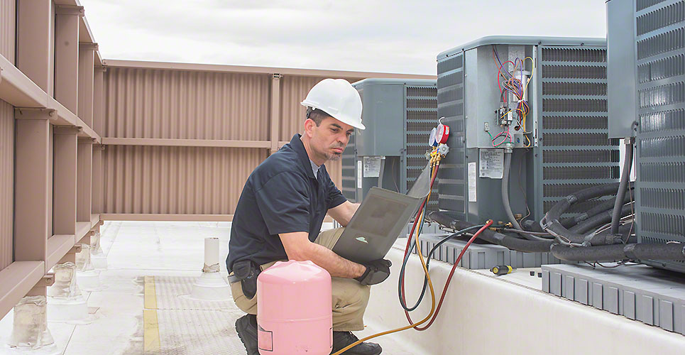 HVAC Technician with panel