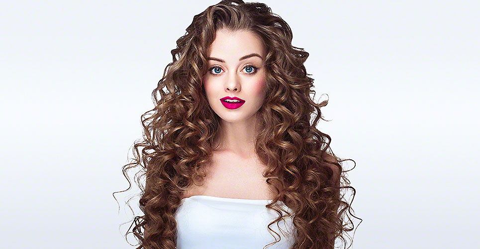 Woman portrait with curly hair perfect make up red lips.